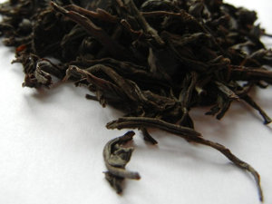 A large-leaf, dark black tea