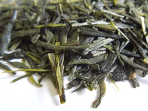 Bright green tea leaves, long and flat