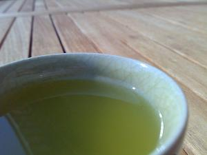 A cup of green tea in a ceramic teacup