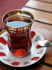 A cup of Turkish tea on a colorful saucer