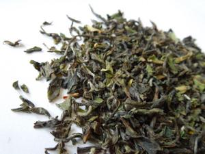 Darjeeling first flush tea leaves, showing a greenish color