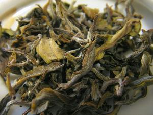 Loose leaf Darjeeling white tea showing a yellowish leaf color