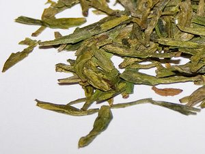 Loose-leaf dragon well green tea with long, flat leaves