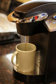 A Keurig machine brewing coffee