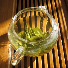 Lu an melon seed leaves steeping in a glass jug