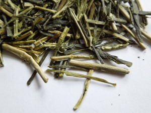 Loose leaf kukicha or twig tea, showing bright green tea stems and twigs
