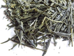 Loose leaf sencha, showing long, intact, dark green tea leaves