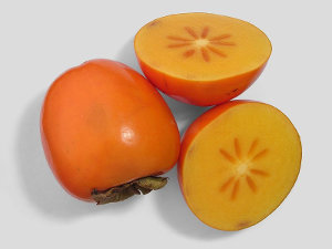 A whole persimmon and a sliced persimmon