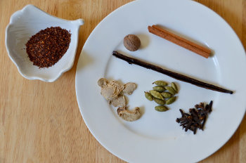 Rooibos on the left, with spices on a plate to the right