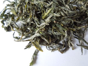 Loose-leaf green tea with pale green, downy leaves