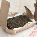Picture of laohuangpian sheng (raw) pu-erh from ancient tea tree 2014 spring