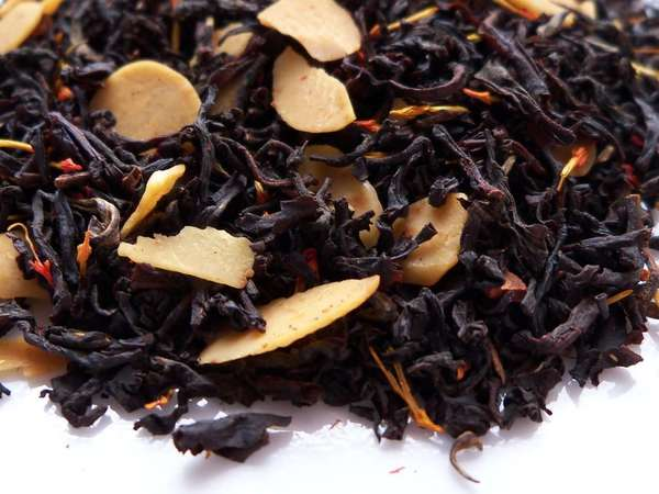 Loose-leaf black tea with whole slices of almond and red-orange safflower petals