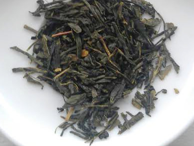 Loose-leaf green tea with fairly dark color, somewhat broken leaf