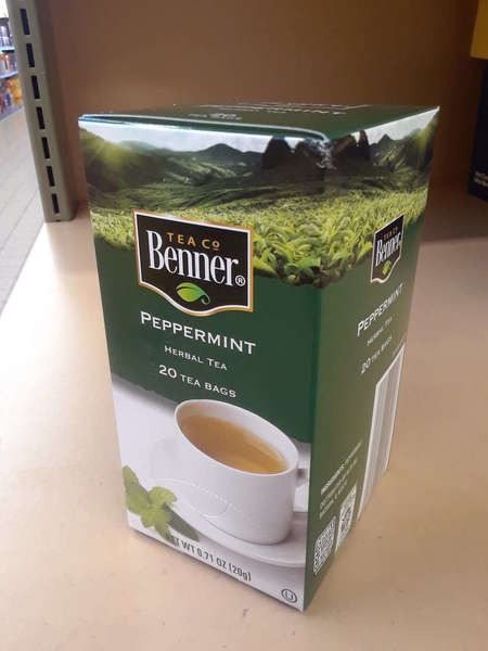 Upright box of Benner Tea Co Peppermint Herbal Tea, green color, on shelf
