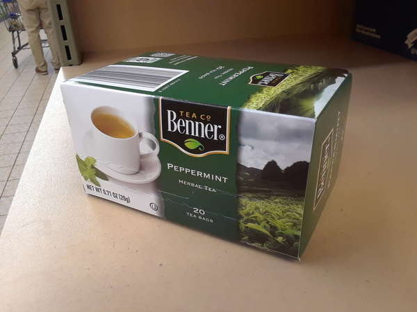 Box of Benner Tea Co Peppermint Herbal Tea, with Green Color scheme, on shelf