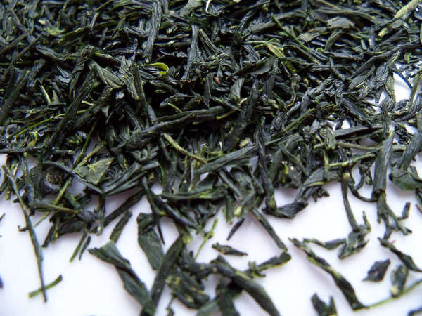 Loose-leaf green tea with long, intact leaves and intense green color