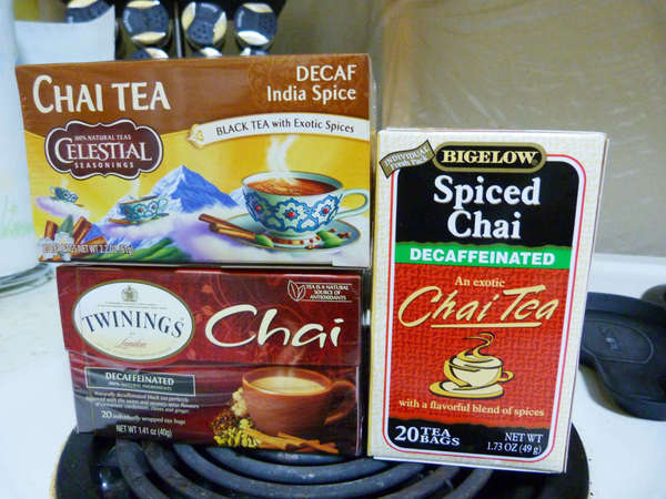 Boxes of Celestial Seasonings Decaf India Spice, Twinings Decaffeinated Chai, and Bigelow's Decaffeinated Spiced Chai tea bags