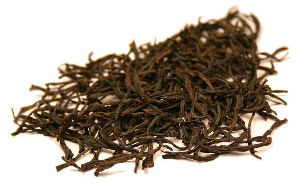 Loose-leaf black tea with long, wiry leaves, all fully intact