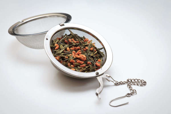 Large, open tea ball infuser filled with genmachi (green tea with puffed rice)