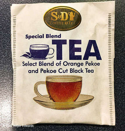 Plain white paper tea bag wrapper with S&D Coffee & Tea logo, reading Special Blend TEA, Select Blend of Orange Pekoe and Pekoe Cut Black Tea, with a teacup pictured beneath