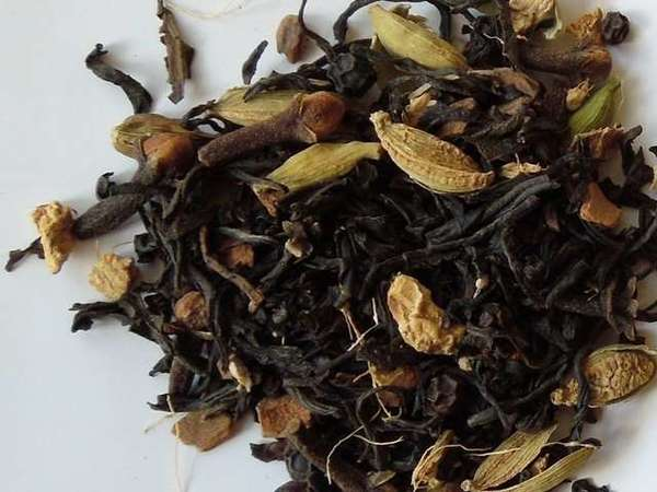 Blend of black tea leaves with green cardamom pods, cloves, and some other dried chunks of spices