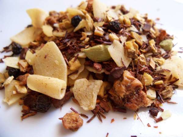 Blend of red rooibos leaf with coconut shreds, green cardamom pods, and various other lumpy and chunky ingredients
