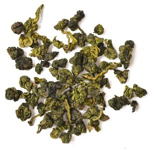 Yellowish green, tightly-rolled tea leaves