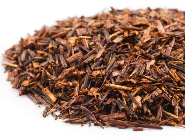Loose-leaf rooibos, with rich red color, looking like small pieces of stem and needle-like leaves